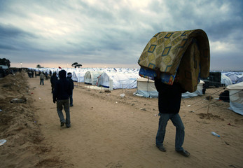 Evacuee walks at a refugee camp in Tunisia