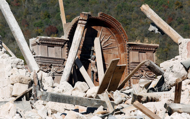 A crucifix is seen in the collapsed San Salvatore church in the village of Campi near Norcia