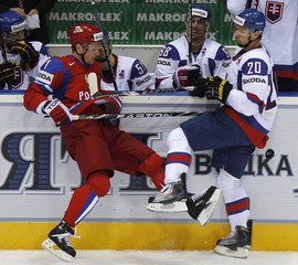 Russia's Kalinin collides with Slovakia's Zednik during their preliminary round game at the Ice Hockey World Championships in Bratislava