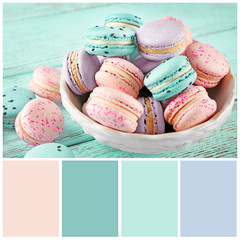 Mint color matching and sweet macarons, closeup