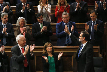 Spain's Prime Minister Mariano Rajoy waves to Popular Party deputies after his state-of-the-nation address in parliament in Madrid