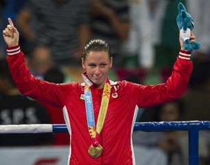 Canada's Mandy Bujold celebrates her gold medal in the women's flyweight boxing finals at the Pan American Games in Guadalajara