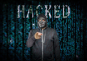 Hacker behind a mask in matrix style