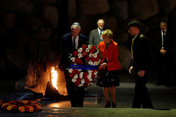 Canada's Governor General David Johnston and his wife Sharon lay a wreath during a ceremony in the Hall of Remembrance at Yad Vashem Holocaust Memorial in Jerusalem