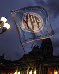 A flag with the YPF logo is waved in front of the Argentine Congress in Buenos Aires