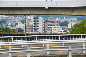 Highway In Hiroshima Japan With Houses On The Background