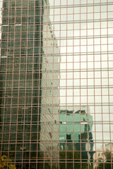 building reflextions on a modern glass building