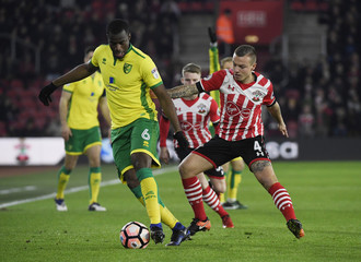 Norwich City's Sebastien Bassong in action with Southampton's Jordy Clasie