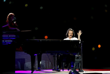 Composer Yanni performs during the Jordan Festival at the Citadel in Amman, Jordan