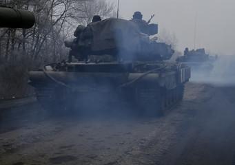 Ukrainian servicemen ride on a tank near Debaltseve
