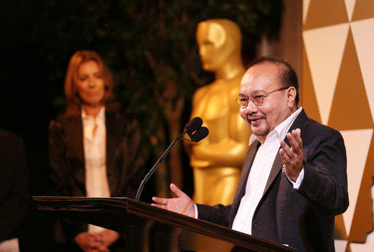 Director Panh accepts his nomination certificate from presenter director Kathryn Bigelow at the 86th Academy Awards Foreign Language Nominee Reception at Ray's and Stark Bar on the LACMA Campus in Los Angeles