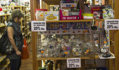 A woman looks at goods at a gift and homeware shop in Madrid