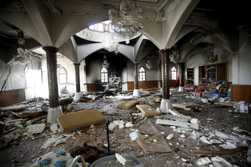 Damage is seen after an explosion at the Quds mosque in Tripoli