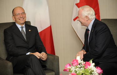 Governor General of Canada Johnston speaks with Italian Prime Minister Letta at the Westin Bristol Place Hotel in Toronto