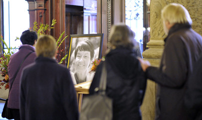 People queue in town hall to sign condolence book for Loki Schmidt wife of former German Chancellor Schmidt in Hamburg