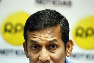 Presidential candidate Humala speaks to the media at a local radio station in Lima