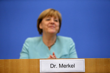 A sign with the name of German Chancellor Merkel is seen in front of her during a news conference at Bundespressekonferenz in Berlin