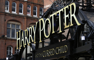 A sign hangs outside The Palace Theatre where the Harry Potter and The Cursed Child play is being staged, in London