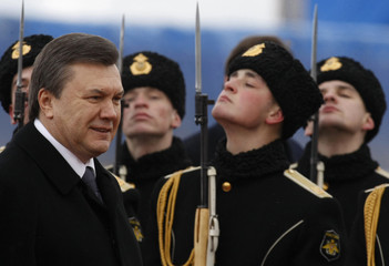 Ukraine's President Yanukovich reviews a guard of honour as he arrives on an official visit at Vnukovo airport outside Moscow