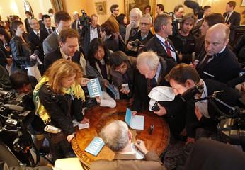 European Union's president Herman Van Rompuy signs a book collecting haiku in Brussels