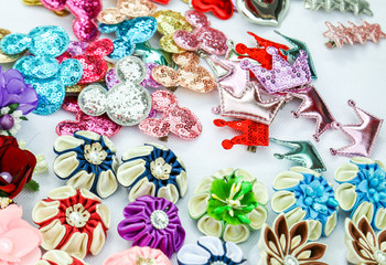 A set of different colored hair-pins and scrunchies