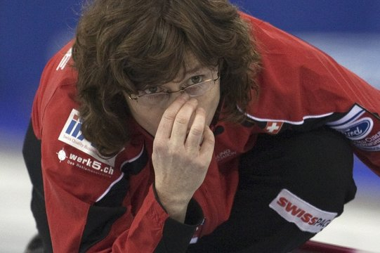 Switzerland skip Mirjam Ott watches the line of her shot over her glasses during their page playoff game at the World Women's Canadian Curling Championships in Lethbridge