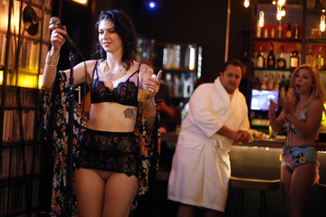 Chelsea Schaefer, 25, is applauded after singing at the first annual Underwear Karaoke, an event that pairs two common fears: being seen in your underwear and singing in public, in Los Angeles