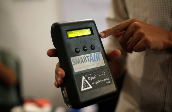 Jay Kannaiyan, who runs a startup Smart Air Filters Pvt Ltd, shows an air quality montior during an interview with Reuters at his office in New Delhi