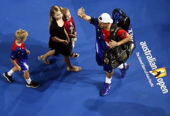 Australia's Hewitt leaves with his children after playing his final Australian Open singles match before his retirement, at the Australian Open tennis tournament at Melbourne Park