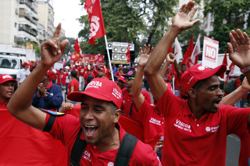 Workers of state-run oil company PDVSA shout during a rally against imperialism in Caracas