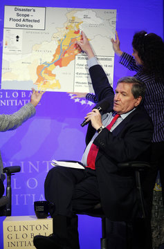 U.S. Special Representative for Afghanistan and Pakistan Richard Holbrooke points out locations of flood-zones on a map of Pakistan during the Clinton Global Initiative