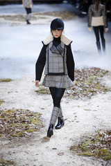 A model presents a creation by Italian designer Giambattista Valli as part of his Autumn/Winter 2015/2016 women's ready-to-wear collection for fashion house Moncler Gamme Rouge in Paris