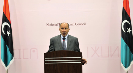 Mustafa Abdel Jalil, chairman of the Libyan National Transitional Council, attends a news conference in Benghazi