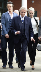 British actor Roache, who plays the character of Ken Barlow in the soap opera Coronation Street, leaves with family and friends after being cleared of all charges at Preston Crown Court in Preston