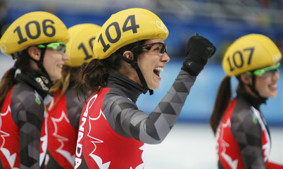 Canada's short track skaters celebrate after their team placed second for the silver medal in the women's 3,000 metres short track speed skating relay final event at the Iceberg Skating Palace during the 2014 Sochi Winter Olympics