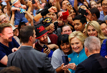 U.S. Democratic presidential candidate Hillary Clinton takes a picture with supporters during a campaign stop in Fresno, California