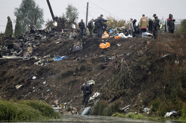 Investigators work at the site of the Yak-42 aircraft crash in the village of Tunishna outside Yaroslavl