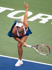 Wozniacki serves a shot Vinci at the Rogers Cup women's tennis tournament in Toronto