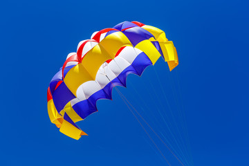 The colorful parachute in the blue sky