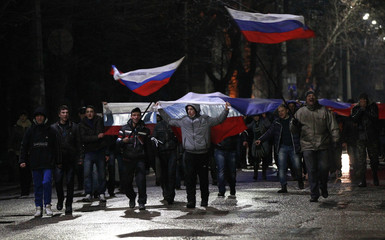 People march with Russian flags during a pro-Russian rally in Simferopol, Crimea