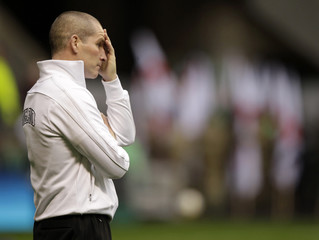 England manager Stuart Lancaster reacts before their Six Nations rugby union match against Ireland at Twickenham Stadium