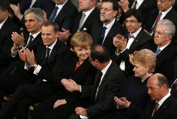 German Chancellor Merkel and President of France Hollande shake hands during the Nobel Peace Prize ceremony in Oslo