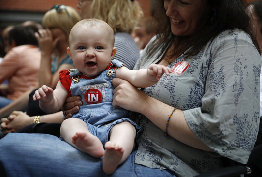 A man wears an England football shirt with a Remain sticker at a Vote Remain event in Manchester