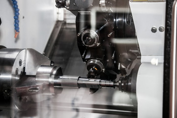 Horizontal CNC milling-turning center with 3-axis double-spindle