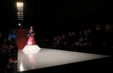 A model displays a creation by Syrian designer Rami Al Ali during his Rome Fashion Week show