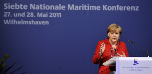 German Chancellor Merkel gestures as she delivers speech during 7th National Maritime Conference in Wilhelmshaven