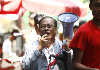 Independent candidate Yan Kyaw attends a campaign rally for Myanmar's upcoming general elections, in Yangon