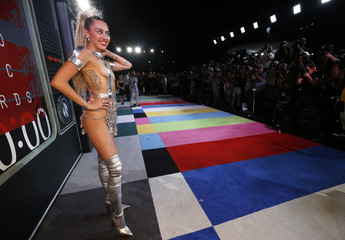Show host Miley Cyrus arrives at the 2015 MTV Video Music Awards in Los Angeles