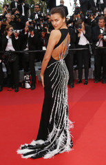 """Model  Irina Shayk poses on the red carpet as she arrives for the screening of the film """"La fille inconnue"""" (The Unknown Girl) in competition at the 69th Cannes Film Festival in Cannes"""
