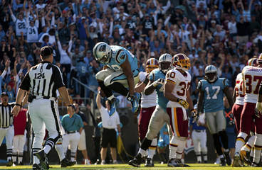 Panthers' Stewart celebrates a touchdown against the Redskins during an NFL football game in Charlotte